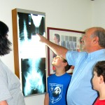 Dr. Deehl viewing x rays of patient