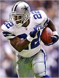 Emmitt Smith running with football